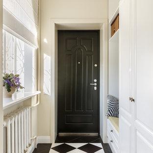 На фото: входная дверь в стиле современная классика с бежевыми стенами, одностворчатой входной дверью, черной входной дверью и разноцветным полом