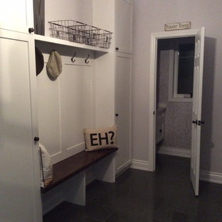 Entryway - mid-sized transitional porcelain floor entryway idea in Toronto with purple walls and a white front door
