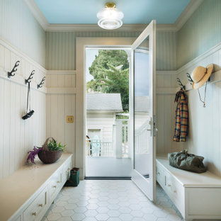 Single front door - coastal white floor, shiplap wall, wainscoting and wallpaper single front door idea in Other with green walls and a glass front door