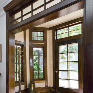 Stained Wood Trim Example Of A Clic Entryway Design In San Francisco With White Walls