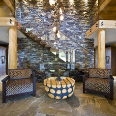 Rustic Entry by Sticks and Stones Design Group inc.