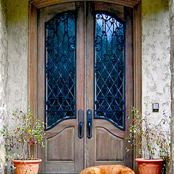Old World Doors - This door, DbyD-3163, is a pair of Double Distressed Cypress Doors with custom Wrought Iron Grills over Decorative Leaded Diamond Glass.  This door is installed on a custom home in Alexander City, Alabama.  The hardware is by The LongLeaf Collection.