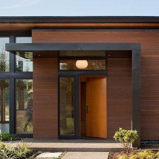 Minimalist single front door photo in Seattle with a medium wood front door