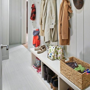 This is an example of a medium sized contemporary boot room in New York with grey walls and grey floors.