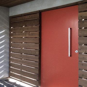 orange pivot gate at courtyard entry