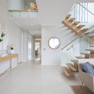 Example of a trendy foyer design in Melbourne with white walls