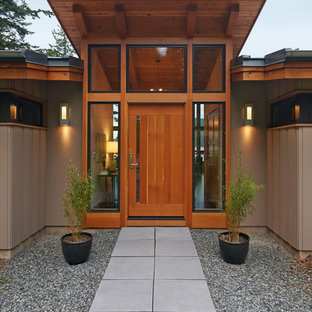 Example of a mid-sized mountain style entryway design in Seattle with a medium wood front door