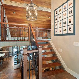 Ispirazione per un grande ingresso moderno con pareti grigie, pavimento con piastrelle in ceramica, una porta singola, una porta in legno bruno, pavimento multicolore, soffitto in legno e pareti in perlinato