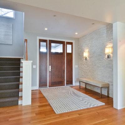 Entryway - contemporary entryway idea in Minneapolis with gray walls and a dark wood front door