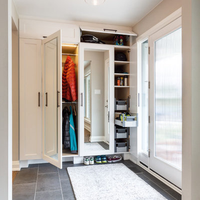 Inspiration for a mid-sized transitional slate floor entryway remodel in Other with gray walls and a glass front door