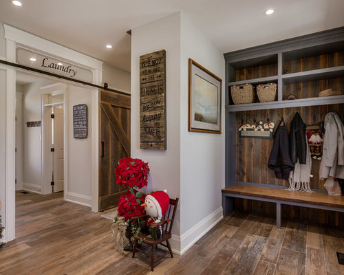 small elegant medium tone wood floor and brown floor mudroom photo in toronto with gray walls - Mudroom Design Ideas