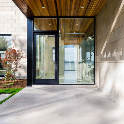 Entryway - contemporary entryway idea in Ottawa with a glass front door