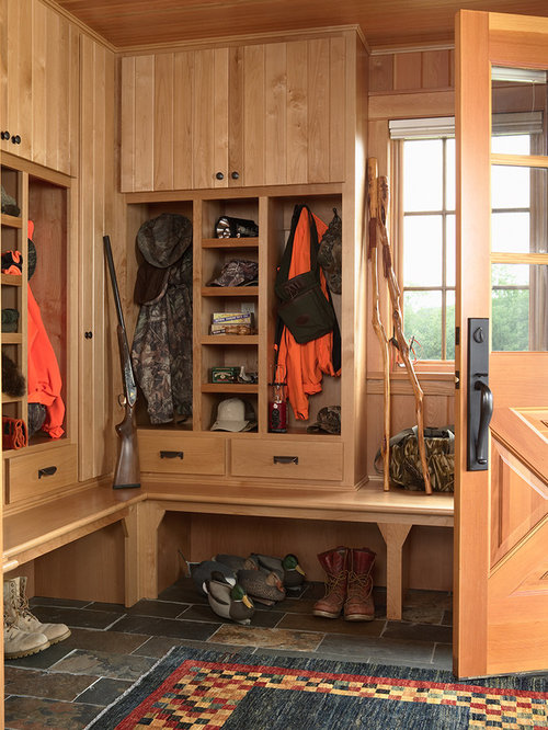 example of a mountain style mudroom design in minneapolis with slate floors and a medium wood. Interior Design Ideas. Home Design Ideas