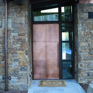 Example of a mid-sized trendy entryway design in Denver with a metal front door