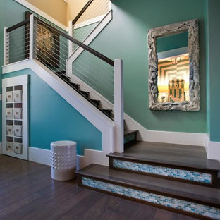 Entryway - mid-sized eclectic medium tone wood floor and brown floor entryway idea in Orlando with blue walls and a blue front door