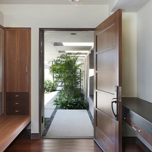Inspiration for a large 1950s bamboo floor entryway remodel in Orange County with a medium wood front door