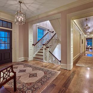 На фото: большая прихожая в классическом стиле с фиолетовыми стенами, паркетным полом среднего тона, одностворчатой входной дверью и фиолетовой входной дверью с