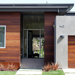 Trendy entryway photo in Los Angeles with a glass front door