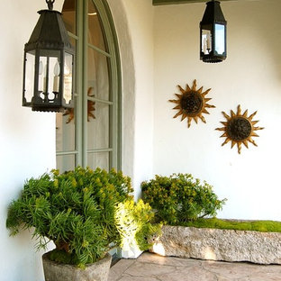 Tuscan entryway photo in Los Angeles with a green front door