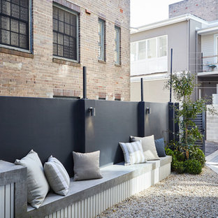 This is an example of a small contemporary entryway in Sydney with grey walls.