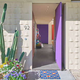 Pivot front door - mid-sized mid-century modern porcelain tile and gray floor pivot front door idea in Chicago with beige walls and a purple front door