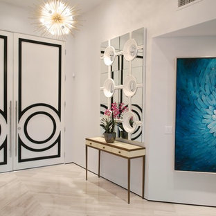 Large trendy ceramic floor entryway photo in Other with white walls and a white front door