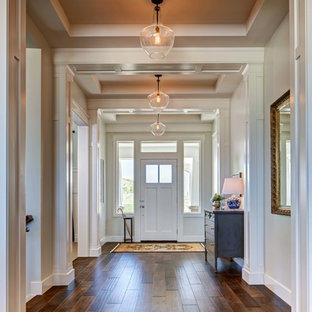 Entryway - traditional entryway idea in Salt Lake City with white walls and a white front door