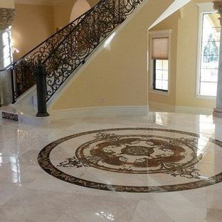 Large elegant marble floor entryway photo in Miami with beige walls
