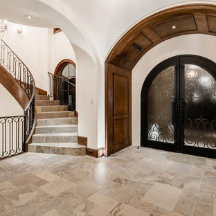Example of a huge transitional marble floor and beige floor entryway design in Phoenix with white walls and a glass front door