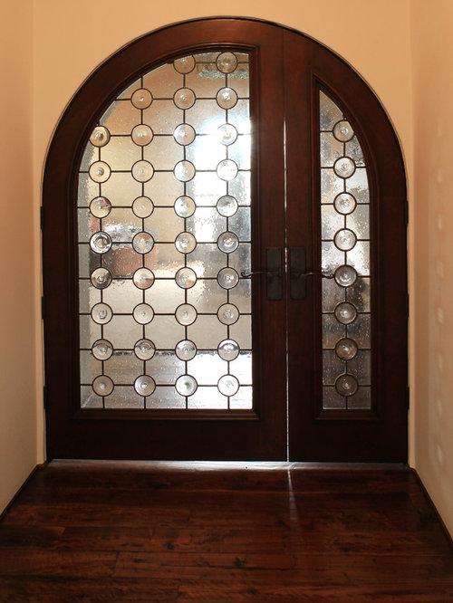 foto e idee per porte d'ingresso - porta d'ingresso con pavimento ... - Porta Dingresso In Legno Massello
