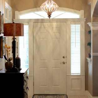 Mid-sized eclectic ceramic floor entryway photo in Other with beige walls and a white front door