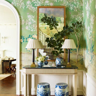Inspiration for a mid-sized timeless medium tone wood floor foyer remodel in New York with green walls