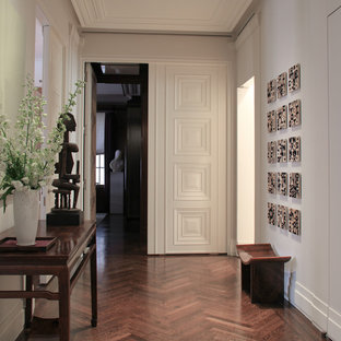 Mid-sized trendy medium tone wood floor entryway photo in Newark with white walls and a white front door