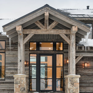 Example of a mountain style entryway design in Salt Lake City with a glass front door