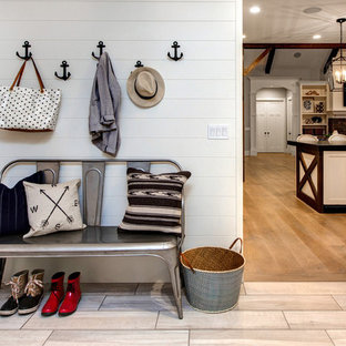 Inspiration for a beach style light wood floor entryway remodel in Salt Lake City with white walls