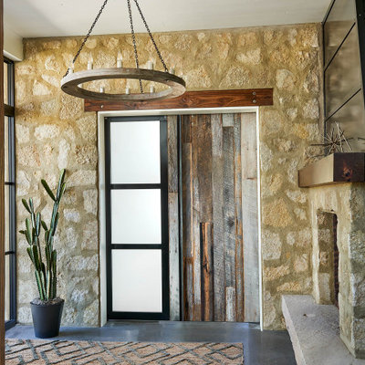 Example of a large cottage concrete floor and gray floor entryway design in Denver with a medium wood front door
