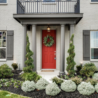 Inspiration for a timeless entryway remodel in Dallas with a red front door
