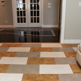 Inspiration for a large contemporary cork floor entryway remodel in Seattle with gray walls and a brown front door