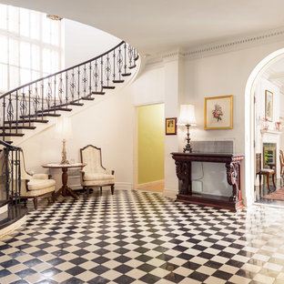 Inspiration for a victorian multicolored floor foyer remodel in New York with white walls