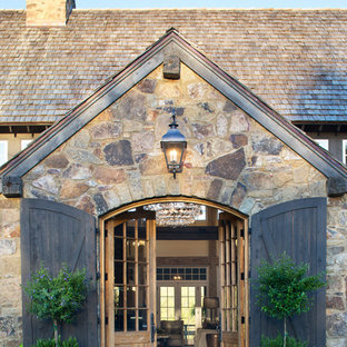 Entryway - large cottage entryway idea in Austin with a dark wood front door