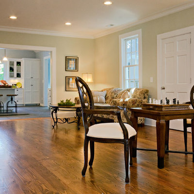 Entryway - mid-sized country medium tone wood floor and brown floor entryway idea in Raleigh with green walls and a white front door