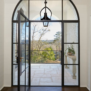 This is an example of a medium sized mediterranean foyer in Birmingham with white walls, dark hardwood flooring and a single front door.