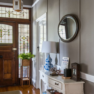 Design ideas for a mid-sized country entryway in Brisbane with grey walls, a single front door, a dark wood front door and medium hardwood floors.