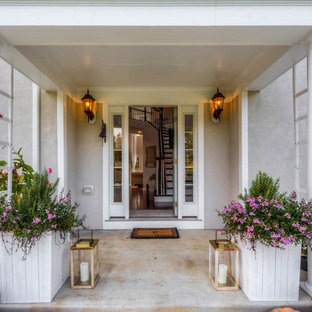 Large elegant entryway photo in Baltimore with gray walls and a white front door
