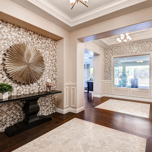 Inspiration for a large transitional dark wood floor entryway remodel in Las Vegas with beige walls