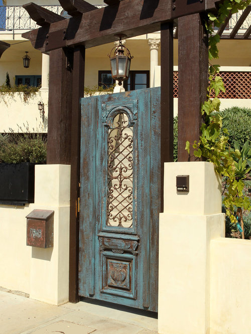 Mediterranean doors home design ideas pictures remodel for Mediterranean style entry doors