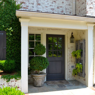 Photo of a traditional entryway in Atlanta with a black front door.