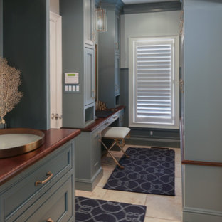 Entryway - mid-sized traditional ceramic floor entryway idea in New York with blue walls and a white front door