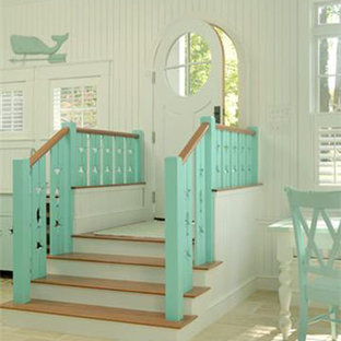 Single front door - tropical single front door idea in Tampa with a white front door