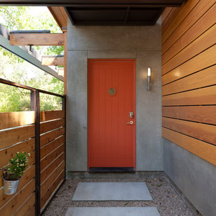 Inspiration for a contemporary entryway remodel in Austin with a red front door